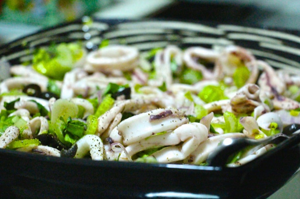 Squid salad with lemon basil and olives