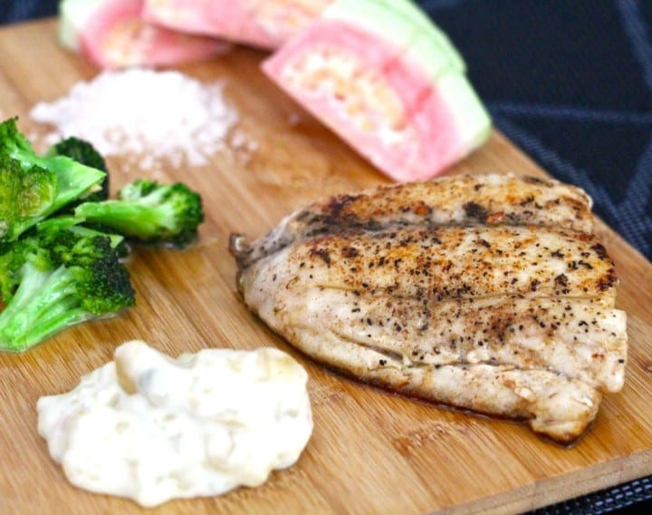 Butter fried fish with pink guava, broccoli and macadamia tartare sauce