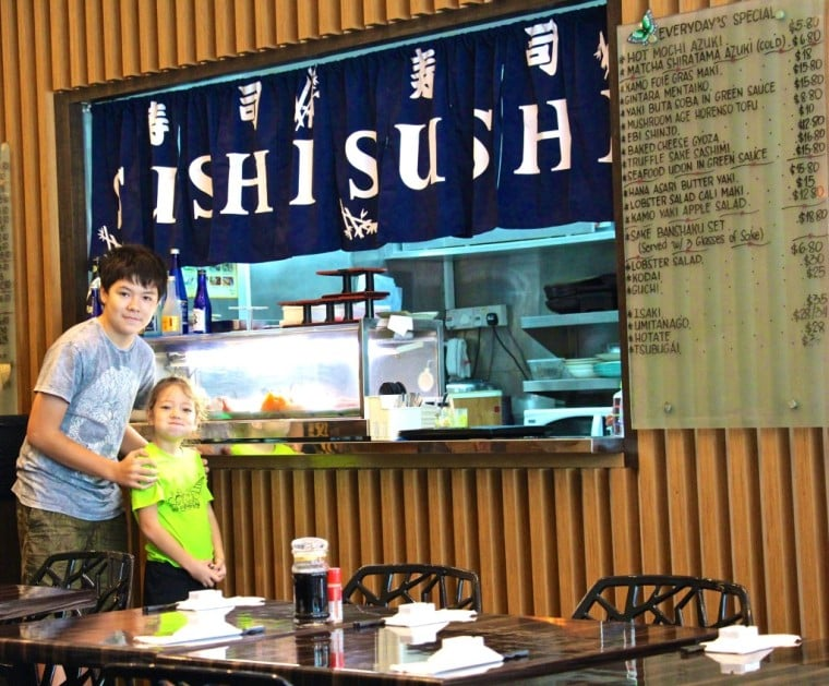 Kids standing at the jump of one of our locals, the wonderful Megumi Japanese Restaurant on East Coast Road. Well worth a visit.